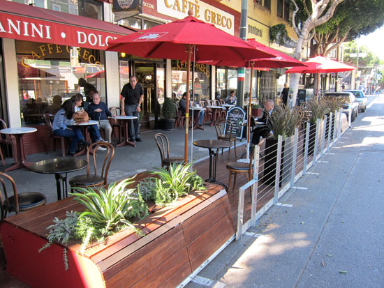 Two parking spaces are now cafe seating, benches and plants. Photos: Matthew Roth