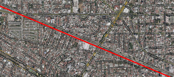 Avenida Inglaterra is just above the red line crossing the image; it is currently a rail corridor with utility lines and limited open space on either side.