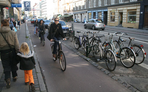 A raised, parking protected bike lane allowing San Francisco cyclists to ride in serenity. Just kidding. That's Denmark. Photo: Streetsblog.