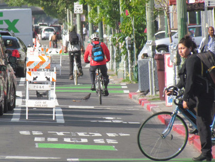 Park to the left, bike to the right. These signs are only temporary, but maybe the city should consider making them permanent. Photo: Melanie Curry/Streetsblog