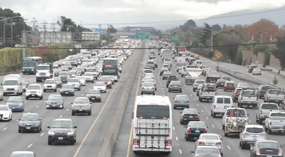 Buses stuck in traffic on today's Highway 101 in San Mateo County. Planners hope to move more people in fewer vehicles by installing express lanes. Photo: TransForm