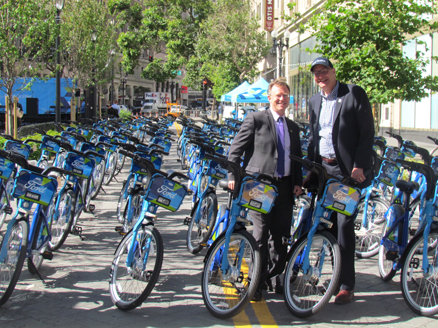 Oakland Transportation Policy Director Matt Nichols and Motivate CEO Jay Walder are ready to ride.