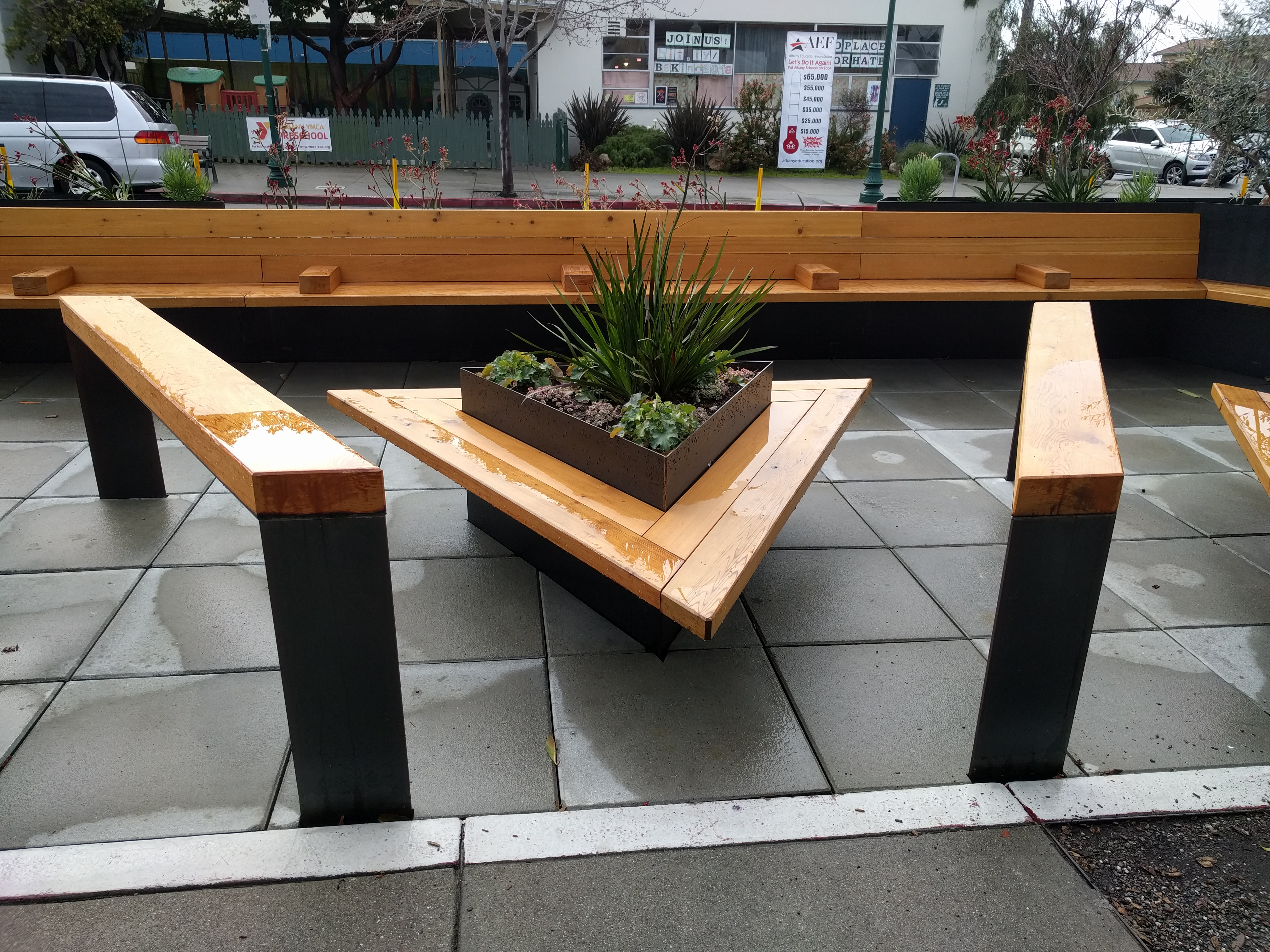 A parklet in Albany. Using a parking space for something other than car storage was unthinkable, until artists and advocates started 'Parking Day'. Photo: Streetsblog/Rudick