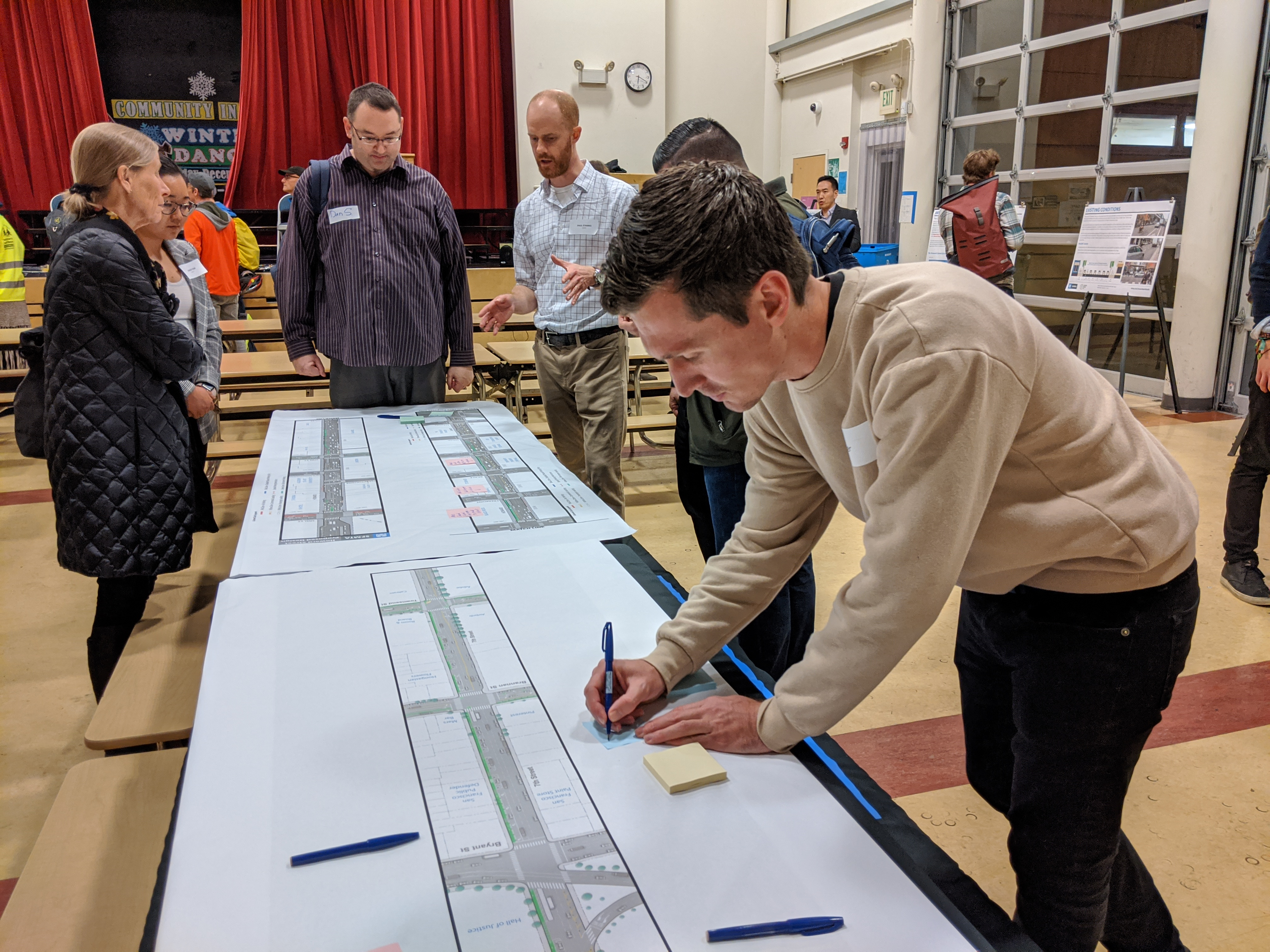 Advocate Parker Day makes notes on the plans at last night's open house