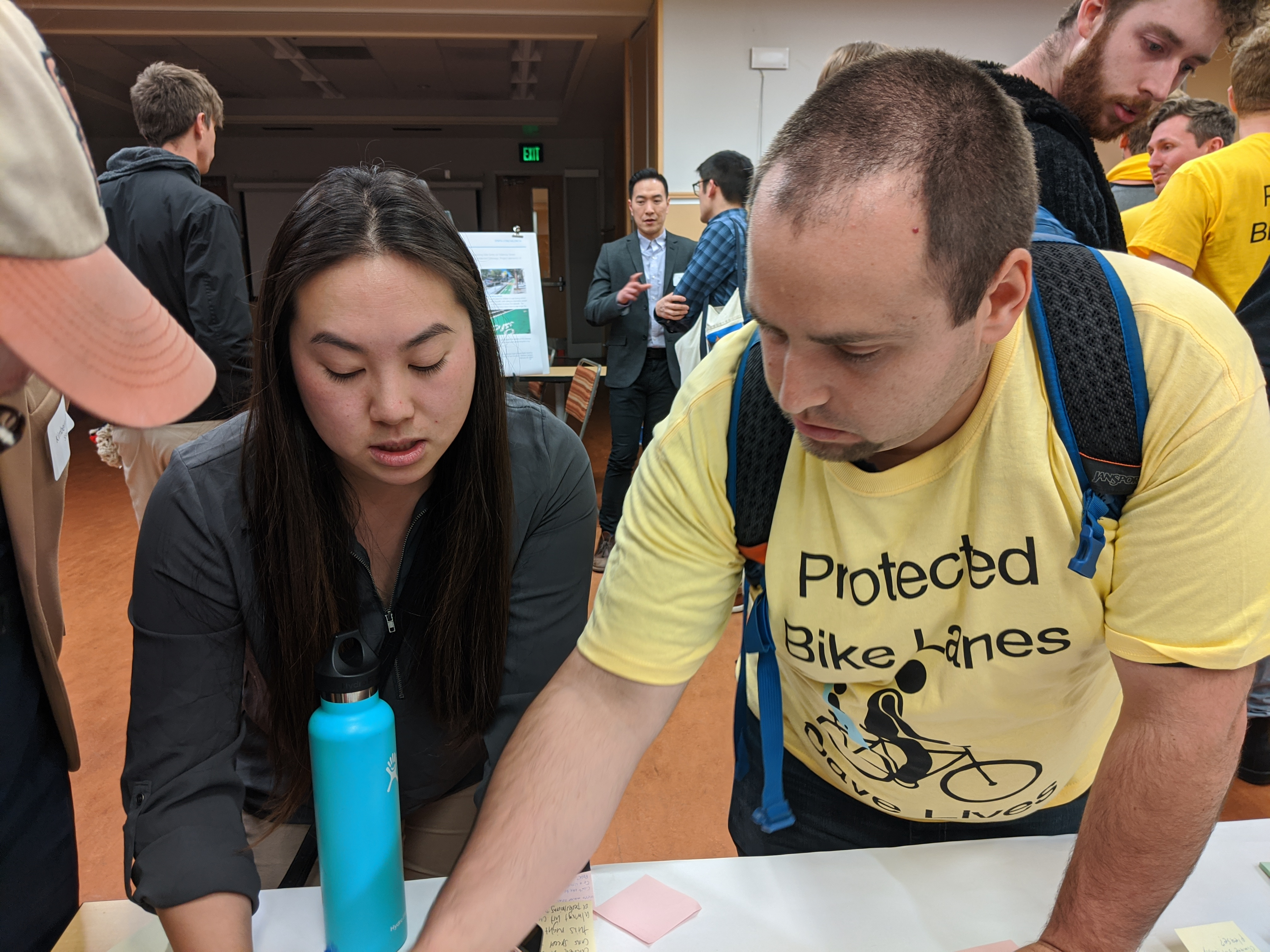 SFMTA engineer Winnie Lee and advocate Bruce Halperin discussing protected intersections at yesterday's open house. Photo: Streetsblog/Rudick